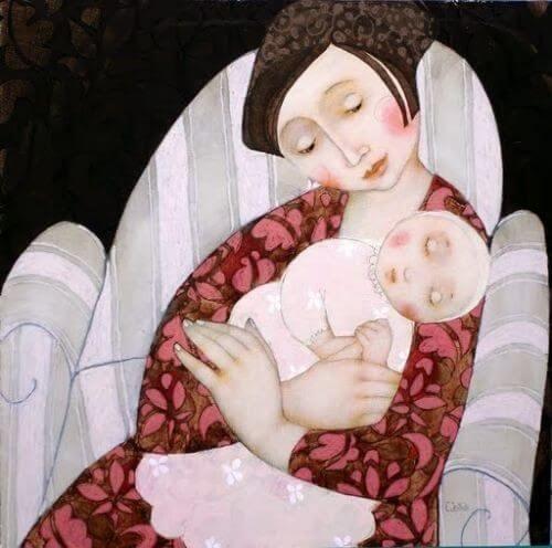 kucağında bebeğini tutan anne tablosu