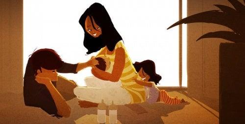 çocuklarına sarılan anne