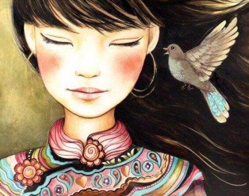 kulağında kuş olan kız figürü