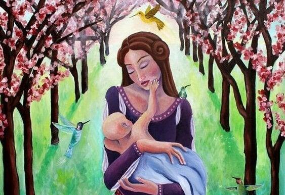 annesinin yüzüne dokunan bebek