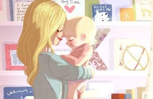 bebeğini tutan anne
