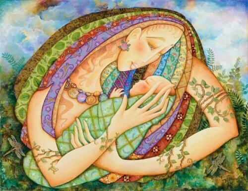 kollarıda bebek tutan anne figürü