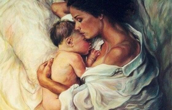 annesinin koynunda bebek
