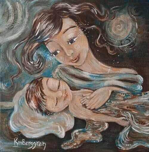 anne çocuğunu tutarken