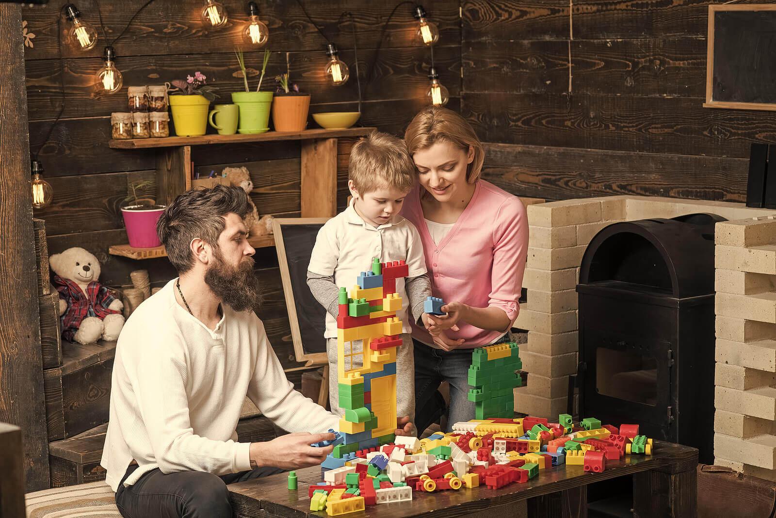 evde lego ile oynayan bir aile