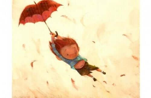 şemsiyeyle havalanan bir çocuk